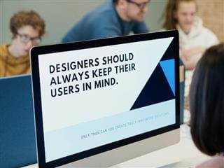 "someone working on a screen which says ""designers should always keep their users in mind"""