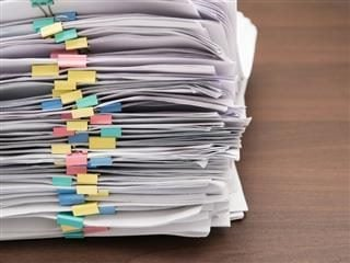 a stack of papers binded by clips.