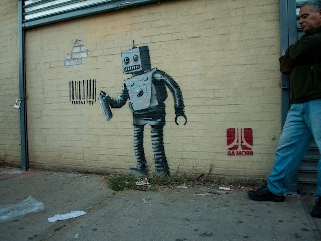 robot graffiti on NYC wall