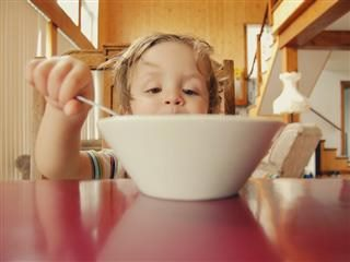 toddler eating a bowl of cereal
