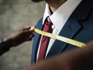 tailor fitting a jacket