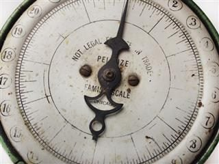 close up of a vintage grocery scale