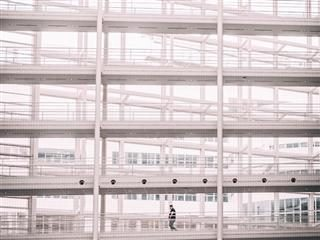 solo person walking through empty hallways of a building