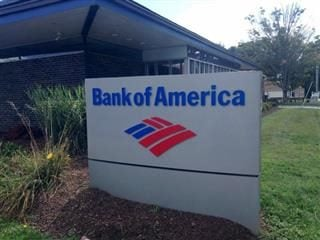 The outside of a Bank of America branch in Newington, Conn., showing a Bank of America sign.