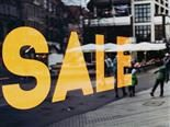 "large  yellow  ""SALE"" sign in a  storefront window"