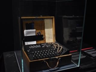 Enigma encryption machine displayed in a museum