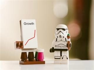 storm trooper figurine with a growth chart