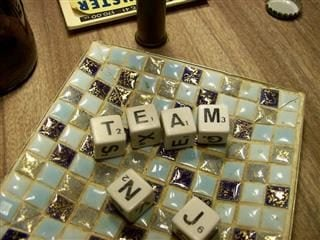 """Scrabble game pieces that spell out """"Team NJ"""""""