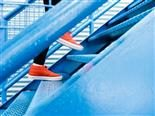 red sneakers on blue stairs