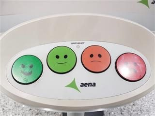 simple survey delivered in airport - buttons showing happy, neutral-happy, neutral-sad, sad