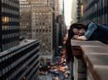 taking a nap on a parapet wall, 40 floors above traffic