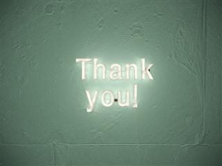 "neon sign that reads ""thank you"""