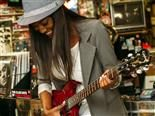 woman-playing-guitar