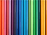 A variety of colored pencils lined up