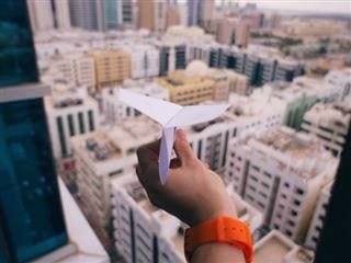 sending out a paper plane