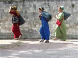 three women walking to market