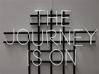"LED sign saying ""The Journey Is On"""