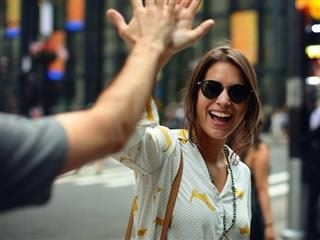 woman giving a high five