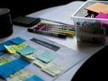 sticky notes, markers, other tools of a design meeting