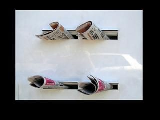 Four newspapers in mail slots.