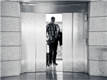 man behind closing elevator doors