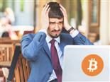 Frustrated bitcoin trader looking at PC