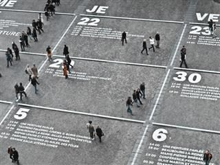 field turned into a large calendar with people walking on top of it