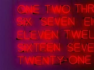 neon sign with numbers written out