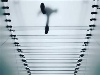 visible person walking overhead on staircase in a store