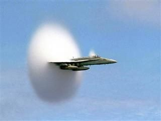 A cloud forms as this F/A-18 Hornet aircraft speeds up to supersonic speed. NASA Goddard Photo and Video
