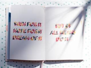 white book on a polka dot background with a text message saying do it