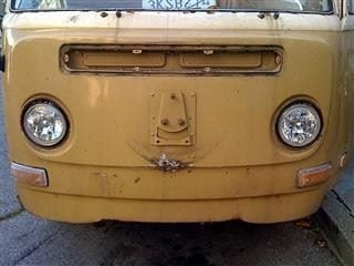The front of a yellow VW-type van.