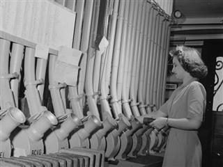 woman sending messages through a pneumatic tube system
