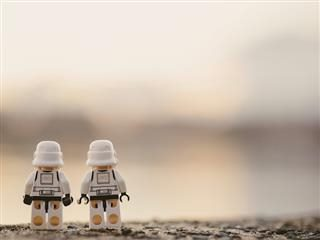 two lego stormtroopers with  their backs to  us