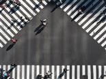 view from above: a triangular intersection with pedestrians