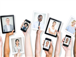 A diverse group of workers each with a head shot on a digital device. - digital workplace personalization concept