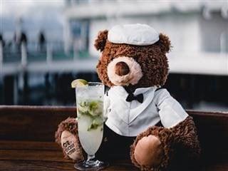 a teddy bear with a cocktail