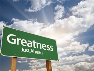 A green road sign that reads Greatness Ahead - Great marketing concept