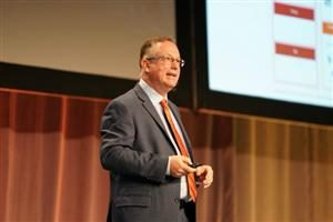 Scott Brinker on stage giving his keynote Tuesday at the MarTech conference in Boston.