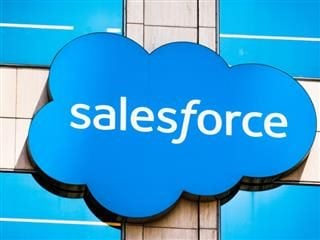 Salesforce logo on a sign on the side of a building