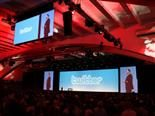 Salesforce CEO Marc Benioff on stage during a past Dreamforce conference with Twitter's logo on the big screen.