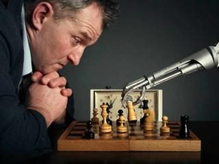 A man playing chess with a artificial intelligence (AI)