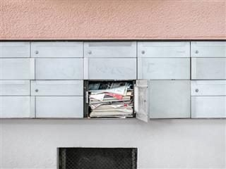 very crowded mailbox