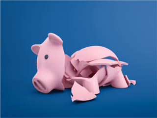 A broken piggy bank on blue background - cost of ownership concept