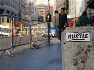 hustle sign on the wall