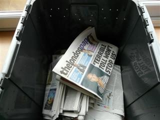 Newspapers inside a container.