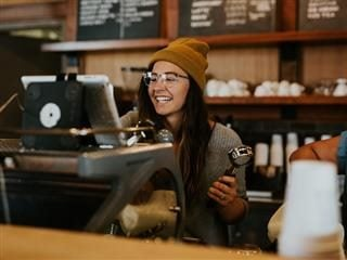 woman working as a barista