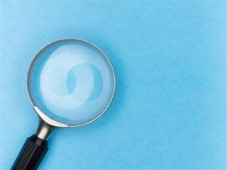 image of a magnifying glass on a blue table