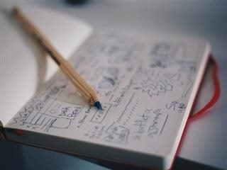 sketching a wireframe in a notebook