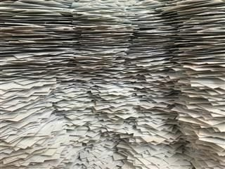 a wall of paperwork